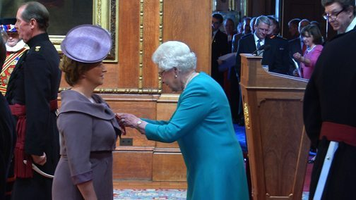 DAme Fiona Kendrick CEO of Nestle receives her Knighthood from the Queen at Windsor Castle