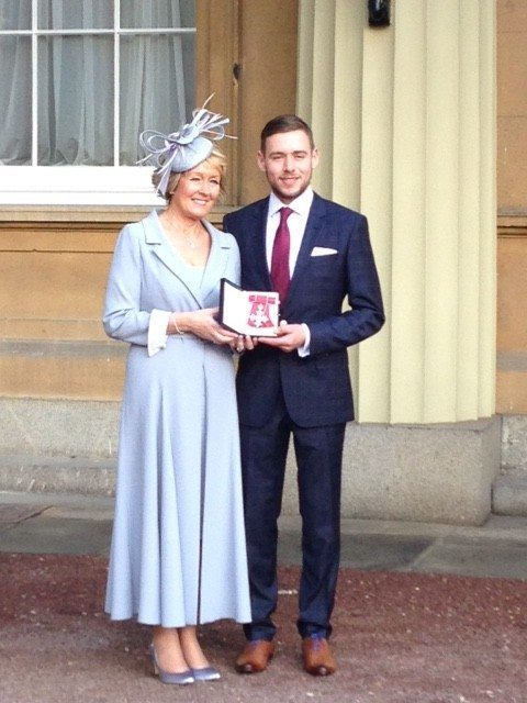 Elaine Inglesby CBE proud moment at Buckingham Palace with her son