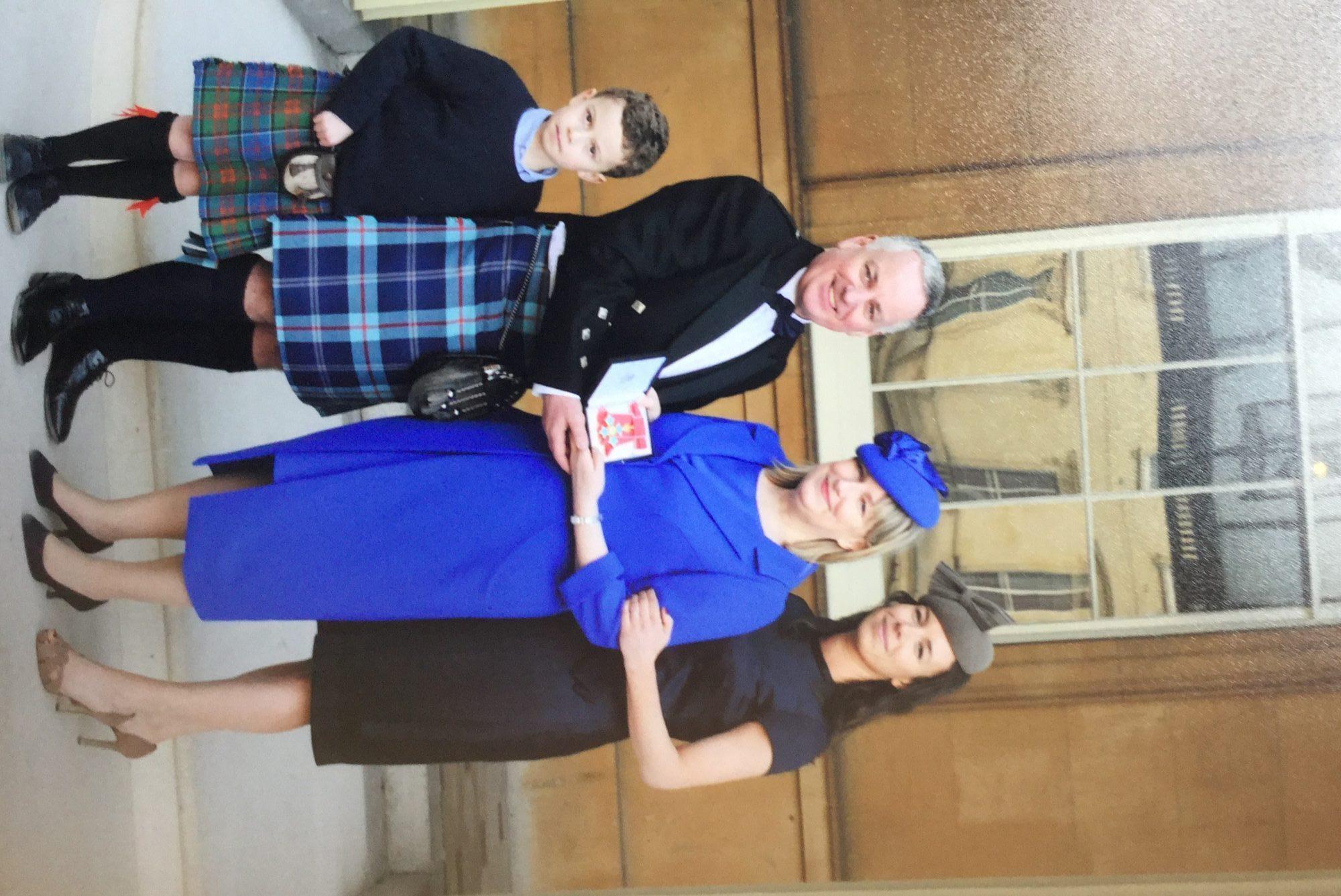 Proud family at Buckingham Palace