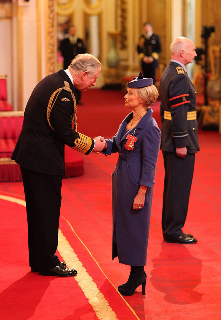 Joyce receives her OBE from Prince Charles at Buckinham Palace