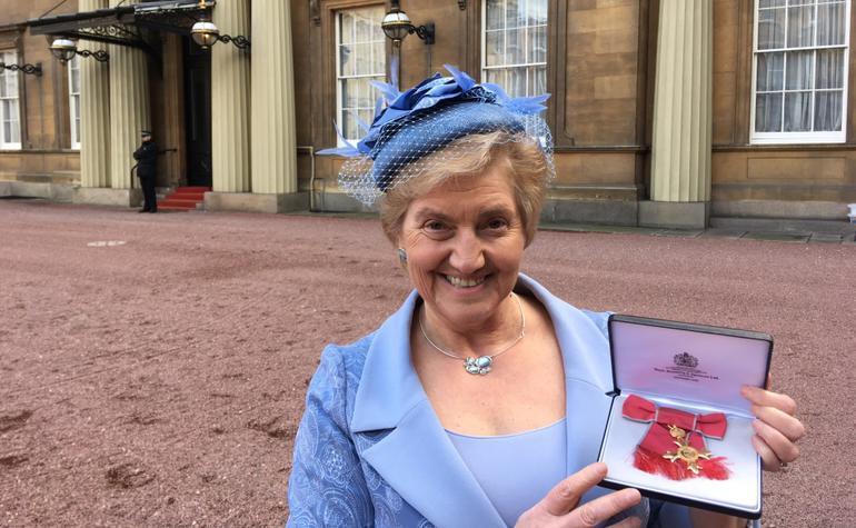 Outside Buckingham Palace after her investiture Dr Lorna Hood poses for the cameras