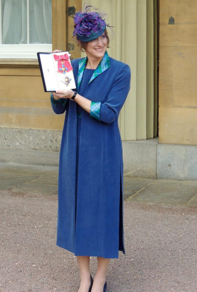 Dame Katherine Grainger Proudly displayes her medal