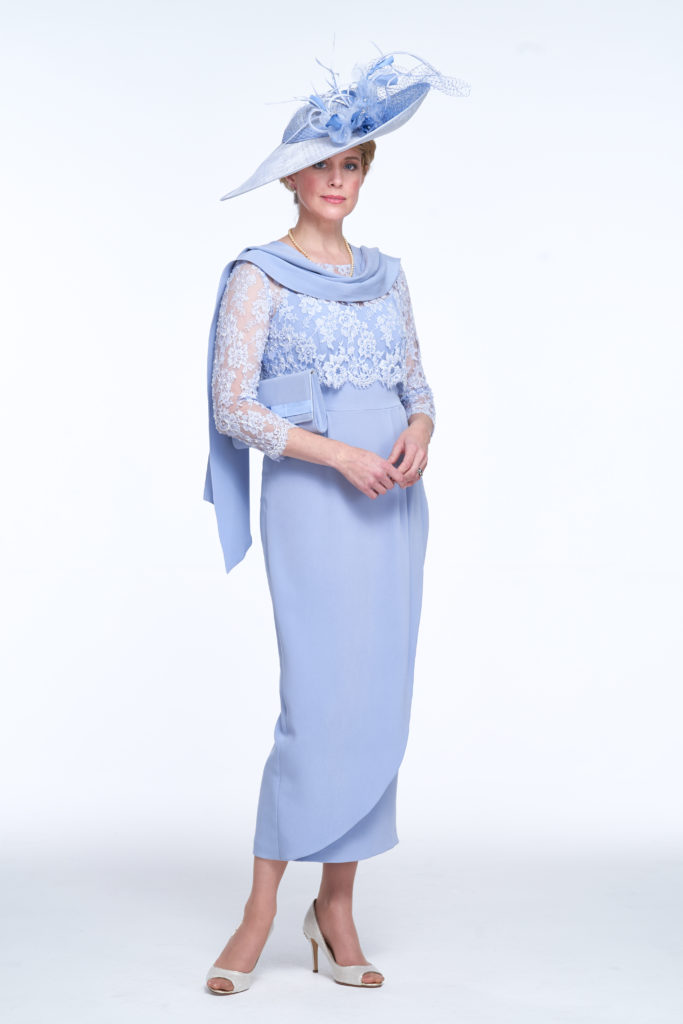 A chic full length dress, with a softly draped tulip skirt shape and wide shoulder straps. The sheer chantilly lace jacket is hand beaded and has a pretty scalloped edging along hemline and cuff. This is a very flattering silhouette. Bespoke hat, bag and scarf are dyed to match to coordinate the whole look.