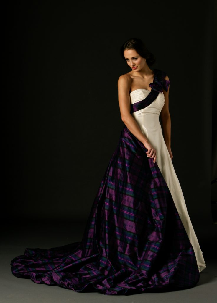 Mirren is a beautiful dress made with silk taffeta, it has one shoulder detail with puff ball hemline on both dress and detachable tartan train.  It comes in a variety of tartans to choose from and is made to measure, so size is never an issue.  The tartan used in our Mirren dress is Tartan Spirit and was designed by Joyce Young and is exclusive to us.  Tartan photographed Tartan Spirit designed by Joyce Young and exclusively available from By Storm in Glasgow and London.