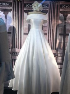 wedding dress with a full skirt and Bardot neckline, virtual